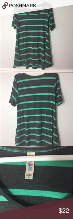 LuLaRoe Perfect T. Gray with green stripes. M. LuLaRoe Perfect T. Gray with green stripes. Size Medium. GUC. Some piling under the arms from wash. I love this shirt, but it's too big now so I'm letting it go. Perfect T runs big. LuLaRoe Tops Tees - Short Sleeve