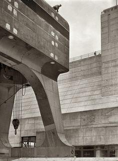 Riveter atop a 250-ton hoist; Cherokee Dam on the Holston River photo by Arthur Rothstein, June 1942