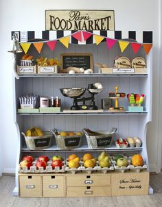 """Food market stand DIY from re-purposed hutch top.  Absolutely adorable, love the use of baskets and flags, very easy to """"un-decorate"""" and use as a bookshelf ones they outgrow the play food."""