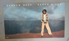 Original autographed promo poster for the Graham Nash album Earth and Sky from 1979. HAND-SIGNED by Graham Nash. Light handling marks.