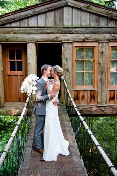 John Crozier's photo of a couple getting married here at THP with Temple of the Blue Moon treehouse behind them.