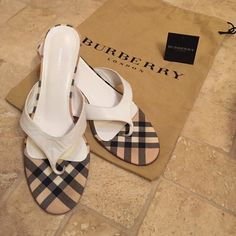 Burberry Kitten Heel Thong Classic plaid & white leather Burberry sandals. Excellent used condition, small mark on back of right heel. Only worn a couple times. Dust bag included. Fits a 7-7.5. Burberry Shoes Sandals