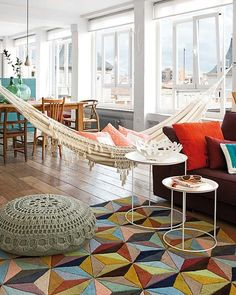 Colorful and bright apartment with a hammock in the living room