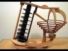 Marble Machines operated by hands Wood Projects, Woodworking Projects, Rolling Ball Sculpture, Marble Tracks, Marble Toys, Marble Machine, Marble Maze, Cardboard Toys, Paper Crafts Origami