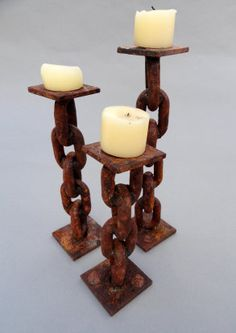 Rusted Chain Candle Holders #SK212012-SK232012 These rustic yet contemporary candle holders provide warmth and charm to any space. Using retired industrial chain and other discarded scraps, Shamus forms these amazing works of art.