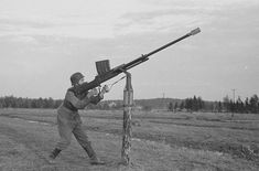 """""""A Finnish soldier uses an anti-tank rifle as an anti-aircraft weapon. Ww2 Pictures, Historical Pictures, Ww2 Photos, Anti Tank Rifle, Germany Ww2, Anime Military, War Photography, Military Diorama, Big Guns"""