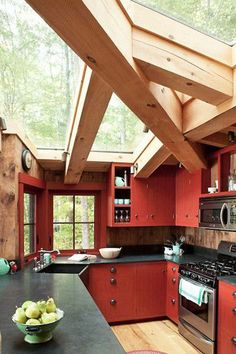 Rustic Red - 28 Cool Kitchen Cabinet Colors  - Photos