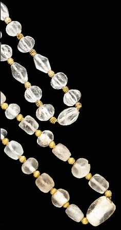 Lot Description  TWO ROMAN OR PARTHIAN ROCK CRYSTAL AND GOLD NECKLACES Circa 1st-2nd Century A.D.