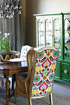 that amazing fabric plus emerald green hutch in background... plus black and white check curtains.