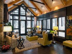 The living wing is the perfect place to retire after a hearty winter's meal.  With walls of glass on either end, light is able to travel deep into the space.  Who's ready to cozy up with a good book?    http://www.hgtv.com/dream-home/living-room-pictures-from-hgtv-dream-home-2014/pictures/index.html?soc=pindhm