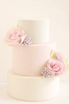 Simplicity itself! Three tiered blush wedding cake with pale, baby-pink blooms