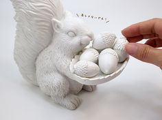 White glass squirrel decor w/ acorns. Love this!