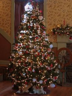 this tree boasts homemade cranberry popcorn garland i love the spinning wheel