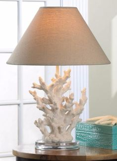 White Coastal Table Lamps... Beautiful sculptural table lamps featuring coral, seashells, seabirds and more. Featured on Completely Coastal.