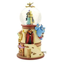 Disney Aladdin Snowglobe | Disney StoreAladdin Snowglobe - Princess Jasmine shares a romantic dance with the handsome Aladdin, whom the Genie has transformed into a dashing prince. The Sultan wonders where his daughter is as Jafar plots more wickedness and little Abu holds a sparkling jewel.