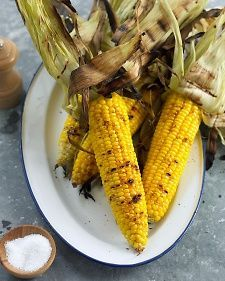 Grilled Corn on the Cob pull husks back, remove silks, pull husks back over cobs. soak 10 mins in water. bbq with husks on for 15 to 20 mins.