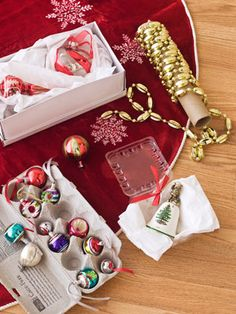 If your original ornament boxes are dented disasters (or you just forgot to save them), don't worry. Ask your local liquor store for wine boxes with cardboard dividers, which you can fold and cut as needed. Then layer two to three ornaments wrapped in tissue paper into each slot, placing heavier ones on the bottom. Try egg cartons for tiny trinkets, plastic produce containers or shoeboxes for bigger baubles, and paper-towel tubes for garlands.