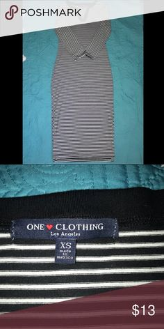 Black and white striped tight dress XS Black and white striped dress. The brand is one clothing Los Angeles. The length from shoulder to bottom of the dress is 42 inches. In great condition only worn once. one clothing Dresses Long Sleeve