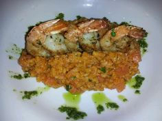 One of my dishes tonight. Tomato Cancasse Risotto with Skrimp. Enjoy. ;)