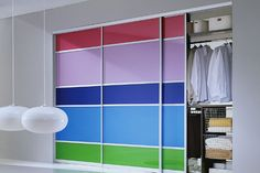 Custom aluminum-framed sliding closet doors with backpainted glass by SpaceSolutions.ca