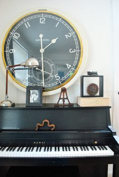 Repainting my piano black and moving it to the living room.  Love the idea of a clock like this over it.  Doooin it!!!