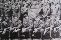 Spreading untruths: Members of the U.S. Army Signal Corps Company-C, 3103rd Battalion are pictured with their guidon. They helped Allied Forces turn the phony 1st U.S. Army Group into reality for the Germans during World War II. U.S. Cleveland of Punta Gorda is the young lieutenant squatting in the front row fourth from the right.
