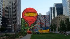 Os Gemeos Otávio and Gustavo Pandolfo - painted in a wall in Boston