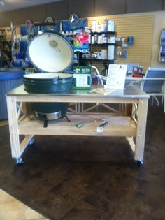 Long Cypress Table with Large Big Green Egg in store ready for you to take it home!!