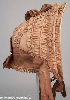Young Girl's Bonnet American Civil War: 1862 Civil War era girl's golden brown silk taffeta spoon bonnet drawn over natural cane, with a buckram and wired foundation, complimenting taffeta bows, chin ties and streamers, with cloth flowers to the under brim, and a buckram lining.