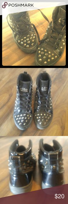Cute To The Core black high top spike sneakers Black canvas and shiny black material. Spike embellishments. Super cute! Bottom of one of the shoes has a little damage it is shown in the photo above. cute to the core Shoes Sneakers