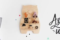 This beautifully cut Wally Wombat treasure board displays your favourite toys and trinkets. It has three separate shelf inserts that cleverly lock together.