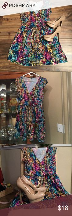 Very versatile. colorful 👗 dress. Very colorful and versatile spring or summer 👗 dress .  This dress hangs just at the knee.  It is a light weight material making it very comfortable.  This dress is a size medium.  It has a wrap dress look 👀 in the front with a tie at the waist for a cute bow.  👚💕. It has a lot of colors for you to play with different accessories.   If you like this dress please feel free to make me an offer. BeBop Dresses Midi