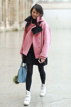 A pink coat and white sneakers. #streetstyle at Paris Fashion Week Fall 2014 #PFW