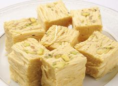 Soan Papdi is one of the famous Indian desserts. It is one of the Diwali sweet w. Soan Papdi is one of the famous Indian desserts. It is one of the Diwali sweet which melts in the mouth leaving its Indian Dessert Recipes, Indian Sweets, Indian Snacks, Comida India, Tandoori Masala, Vegetarian Recipes, Cooking Recipes, Desi Food, Profiteroles