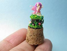 Check out this item in my Etsy shop https://www.etsy.com/listing/219261689/micro-clay-cute-pink-fairy-on-cork-top