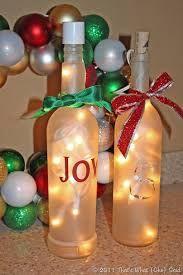 Christmas wine bottles Lighted Wine Bottles, Bottle Lights, Empty Wine Bottles, Christmas Wine Bottles, Wine Bottle Corks, Diy Bottle, Bottles And Jars, Wine Bottle Crafts, Glitter Wine Bottles