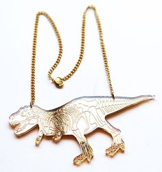 """DESIGNOSAUR  """"Dinosaur Skeleton Necklace"""" in gold acrylic. A design that's been 65 million years in the making, and the signature piece for Brighton-based design group Designosaur, these dinosaur necklaces come packed in their own Designosaur branded box, ready to give as the perfect quirky jewelry gift. ROAR! http://www.culturelabel.com/mirrored-gold-t-rex-dinosaur-necklace.html"""