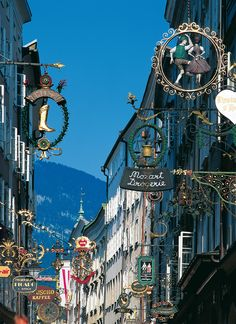 What beautiful architecture! And an amazing background! Could Mozart have gotten his musical inspiration from such a beautiful landscape?   Getreidegasse in Salzburg, Austria.