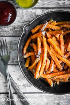 Sweet potato fries that are super healthy because they are baked then topped with fresh parmesan cheese and seasoning. Golden brown and crispy recipe!
