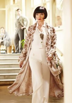 Miss Fisher Murder Mysteries. A pair of wide leg pants, modest top and long jacket or wrap is almost dress like and a very vintage alternative to dresses.