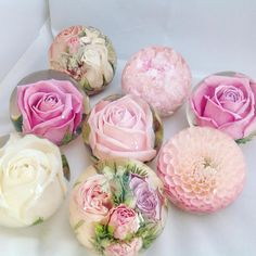 Have you ever thought about preserving your bridal bouquets into paper weights? Now this is an idea…