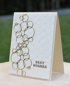 handmade card by Dixie Cochran ... white and gold ... die cut circles (Memory Box)  .... embossing folder big dots background texture ... clean and simple layout with glam look ...