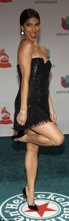 Roselyn Sanchez... In a mini black dress