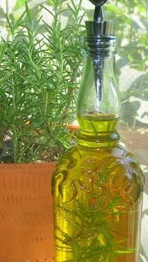 How to Make Rosemary Oil... There is a trick, it's more than just dropping some herbs in a bottle.  So good when done right!