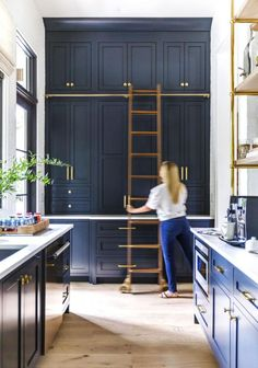 A Rolling Library Ladder Is the Secret to Getting More Kitchen Storage Tidy Kitchen, Kitchen Storage, Kitchen Ideas, Tall Kitchen Cabinets, Blue Cabinets, Ladder Storage, Library Ladder, All White Kitchen, Florida Home