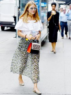 Olivia Palermo looks feminine and chic while out in NYC in an off the shoulder top and a floral print maxi skirt