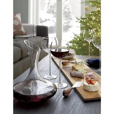 Love these tall stemed glasses -- Camille 23 oz. Red Wine Glass | Crate and Barrel
