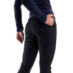 Ski pants: MEC Rocka Nordic Tights - Slim leggings for streamlined performance. With a windproof fabric on the front and a breathable fabric on the back, these tights protect you from the elements, but also give you a place to let off steam. The boot cut fits easily over cross-country ski boots, with a gripper elastic at the cuff to make sure they stay put.
