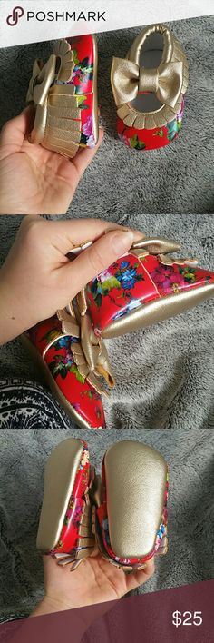 Baby moccasins Brand new never worn. Size 3-6 months (I think they might fit a little bigger than that also) these are absolutely DARLING!! beautiful red and floral pattern with gold details! Bottoms are also gold. The bows add a wonderful touch! Bought from boutique don't know the brand Shoes Moccasins