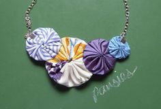 new this week and perfect for spring! ---> pansies - cotton and silk yoyo necklace by cookoorikoo on Etsy, $25.00